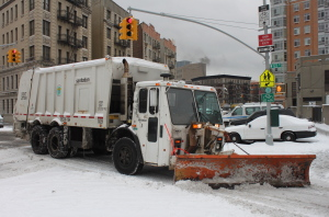 NY Sanitation department garbage truck equipped with snow plow. (Image by Jospeh A - Flickr)