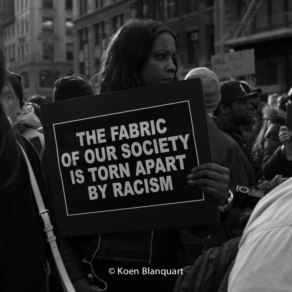 Protesters call out on the racist aspects of the recent police violence during the Millions March NYC. (Image: Koen Blanquart)