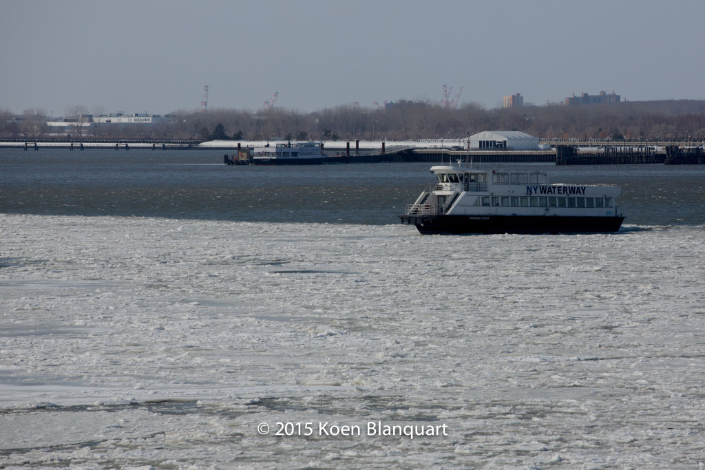 A NY Waterway ferry changes it route to break the ice near the Liberty Landing Ferry Service Ferry
